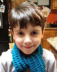 picture of a seven year old boy with a blue scarf